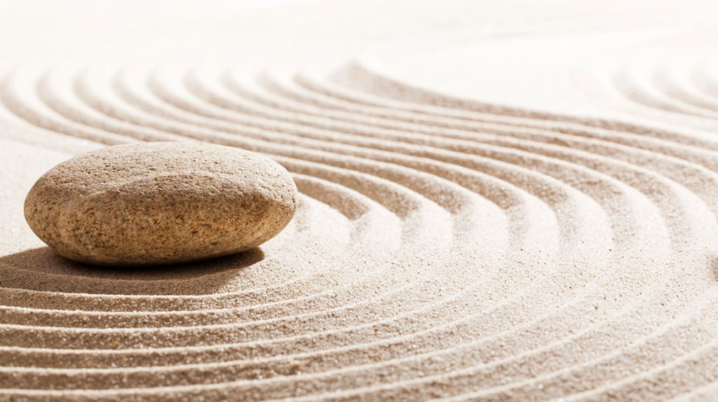 peaceful photo with stone and sand
