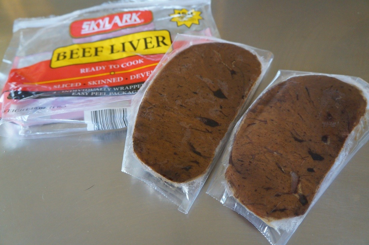2 pieces of frozen liver wrapped in clear plastic packaging